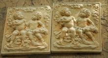 Pair of cast stone putti and garland wall plaques. H:
