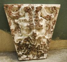 Large cast stone tapering face of a satyr wall plaque.