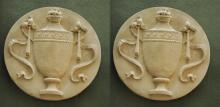 Pair of cast stone neoclassical style urn form roundel