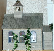 Modern doll's house in the style of a church