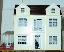 Modern doll's house, Georgian style, opens