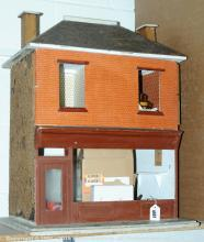 Old fashioned shop doll's house, with two rooms
