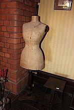 Antique mannequin on turn adjustable base