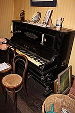 Antique ebonized upright piano with original