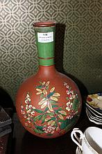 Large antique bottle form terracotta vase with