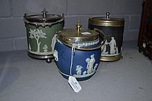 Three Wedgwood china biscuit barrels, black, blue