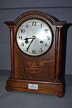 Oak inlaid bracket clock, no key, has pendulum,