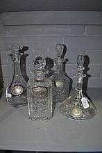 Four glass decanters with spirit labels, approx