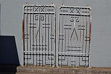 Pair of Art Deco wrought iron warehouse gates,