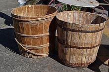 Two large wooden sroting barrels to include one