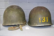 Two old combat helmets (2)
