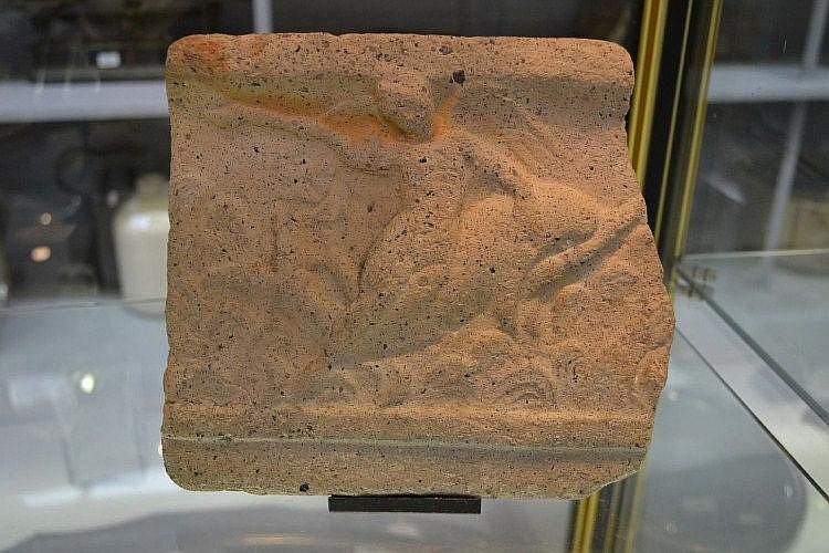 Ancient Sima fragment in terracotta, Eros, naked