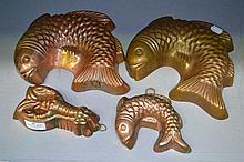 Four copper seafood mousse moulds (4)