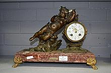 Antique French figural clock of a putto with a