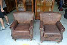 Pair of leather arm chairs, studded trim and