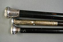 Three English sterling silver topped canes, one