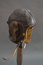 Vintage brown leather flying helmet on stand