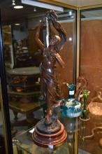 Antique French spelter figure of a maiden, signed to base, on a wooden faux marble base,  approx 52cm H