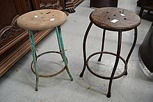 Two old industrial factory stools with steel bases