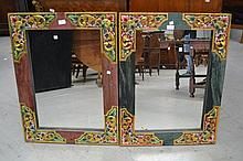 Two decoratively painted wooden mirrors, approx