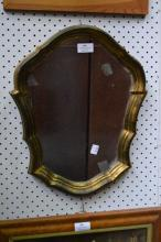 Small gilded crest form mirror, approx 43cm x 35cm
