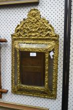Antique French Napoleon III brass cushion mirror, approx 60cm x 33cm