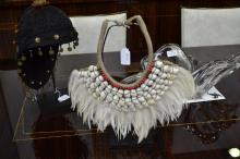 Traditional Papuan shell and feather necklace on stand, approx 38cm H