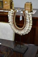 Traditional Papuan 'Teeth' necklace on metal stand, approx 44cm H