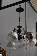 Art Nouveau style three light chandelier with antique shades