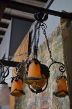French Art Nouveau wrought iron and mottle glass shades, of trumpet flower head form