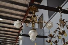 French bronze tri form three light chandelier, fitted with down swept flambe form shades, approx 60cm dia x 70cm H