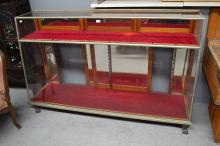 Vintage nickel plated brass slope front shop display cabinet, approx 116cm H x 180cm W x 52cm D