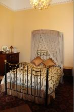 Antique ½ tester queen size bed restored with all drapery, valance, netting cushions, etc