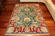Good thick hand knotted wool carpet, Morris design, approx 195cm x 141cm