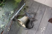 Bronze bell on scroll metal wall bracket, with pull chain