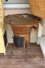 Antique copper heater, with wrought iron legs, approx 77cm H