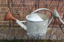 Antique gal metal watering can