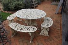 Cast metal antique style garden suite, comprising table and four bench seats (5)