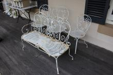 Four piece French metal garden chairs