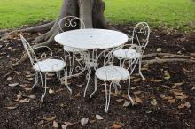 French five piece garden suite, comprising a table and four chairs (5)