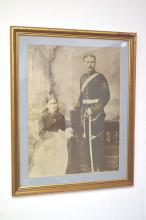 Framed large photograph of 19th century artilleryman and wife, approx 65cm x 52cm