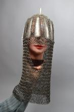 A choice old Caucassion top, heavy butted chain mail with silver koftgari steel panels and head piece.