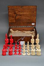 Antique turned bone chess set along with an oak