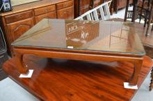 Glass topped coffee table with interesting Chinese characters underneath, approx 32cm H x 96cm L x 66cm W