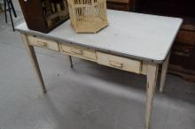 Cream painted plastic top Danish style three drawer table, approx 123cm W x 61cm D x 76cm H