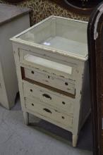 Small painted glass topped cabinet, three drawers below on turned legs, approx 80cm H x 52cm square