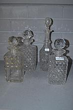 Assortment of cut crystal decanters, approx 32cm H