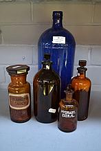Four amber glass chemist bottles along with a