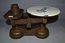Antique scales with porcelain plate printed with
