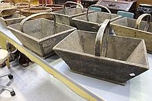 Two antique French wooden baskets, each with bentwood handles (2)